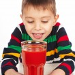 Boy with tomato juice — Stock Photo