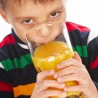 Boy drinking orange juice — Stock Photo