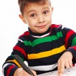 Stock Photo: Boy draws marker on paper