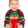 Boy with tomato juice — Stock Photo
