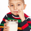 Boy with glass of milk in hand — Stock Photo