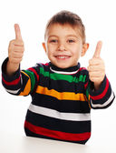 Smiling little kid with thumbs up sign — Stock Photo