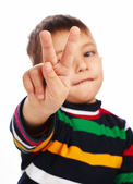 Little boy showing victory sign — Stock Photo