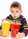 Boy with tomato and orange juices — ストック写真