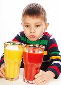 Boy with tomato and orange juices — Stok fotoğraf