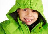 Laughing boy dressed in a warm winter jacket — Stok fotoğraf