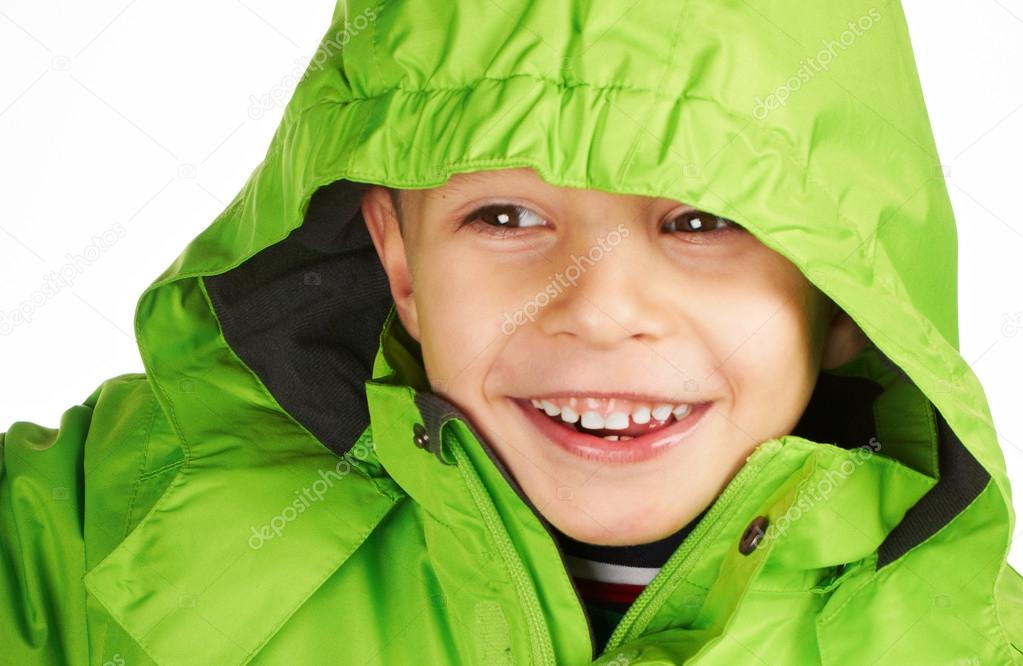 Laughing boy dressed in a warm winter jacket green color — Stock Photo #18317207