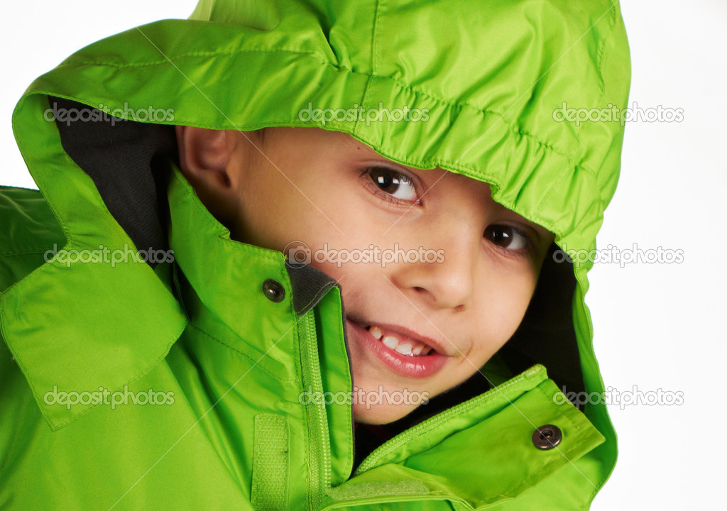 Laughing boy dressed in a warm winter jacket green color — Stock Photo #18317209