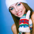 Attractive girl in mittens — Stock Photo
