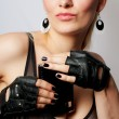 Stock Photo: Young lady in rock style with flask