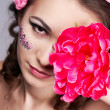 Stock Photo: Girl with beautiful visage and flowers in her hair