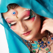Stock Photo: Girl with a beautiful visage and handmade jewelry