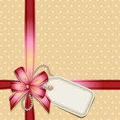 Gift bow with a blank tag — 图库矢量图片