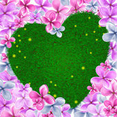 Heart made of grass in frame of lilac flowers — Stock Photo