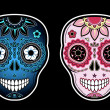 Stock Vector: Two sugar skulls