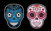 Two sugar skulls — Stock Vector