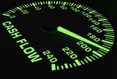 Speedometer showing rising of cash flow — Stock Photo