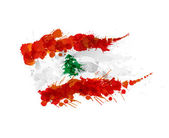 Flag of Lebanon made of colorful splashes — Stockvector