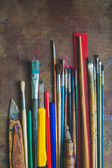 Set of paint brushes and office supplies on the table — Stock Photo