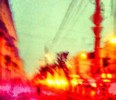 Blurred cityscape with traffic jam at weekday — Stock Photo
