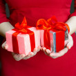 Girl holding gifts — Stock Photo