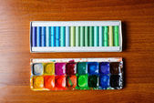 Pastel pencils and watercolor paintbox — Stock Photo