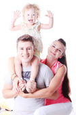 Lucky, happy young family. On the white background. — Stock Photo