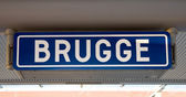 Sign with the name of the railway station. Bruges, Belgium — Foto de Stock