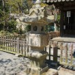Japanese traditional stone lantern in Great Buddha temple — Stock Photo #41193903