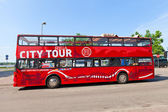 Red city sightseeing bus in Riga, Latvia — Stock Photo