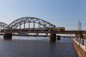 Train on the bridge over Daugava River. Riga, Latvia — Stock Photo