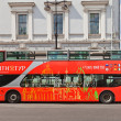 Постер, плакат: Red city sightseeing bus in Saint Petersburg Russia