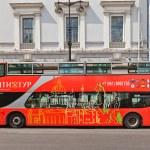 Постер, плакат: Red city sightseeing bus in Saint Petersburg Russia