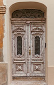 Old wooden decorated door in  Zagreb, Croatia — Stock Photo