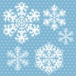 Wektor stockowy : Vector snowflakes set on blue retro background.