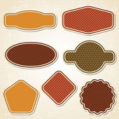 Textured labels and stickers set in retro style. — Stockvektor