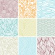 Set of nine colored wavy curly seamless textures - Stock Vector