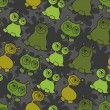 Abstract seamless pattern with cute monsters. - Stock vektor