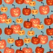 Halloween seamless pattern with pumpkins. — Stock Vector