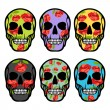 Set of skulls with flowers. — Stock Vector #42969615