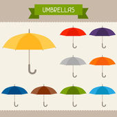 Umbrellas colored templates for your design in flat style. — Stock Vector