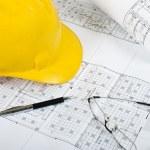 Working on house blueprints — Stock Photo