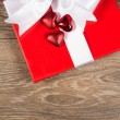 Stock Photo: Giftbox and red hearts