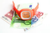 Wristlet watch with banknotes — Stockfoto