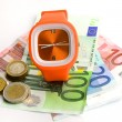Wristlet watch with banknotes - Stock Photo