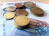 Coins and banknotes — Stock Photo