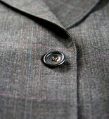 Close up of a suit button — Стоковое фото