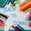 Stock Photo: White and blue slate with various colorful school supplies