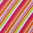 Colorful striped fabric pilling — Stock Photo