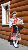 The smiling girl in folk costume — Stock Photo